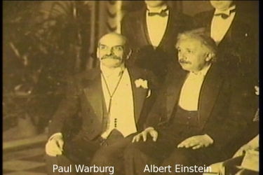 Paul Warburg, founder of the 1913 Federal Reserve Bank, presents Albert Einstein (see e.g. The Money Masters (c)1997 Documentary by Patrick S.J. Carmack, B.B.A., J.D. William S. Still & Robert Krueger, Rick James)